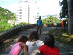 Gilrs line up the shots in Favela Morro dos Prazeres